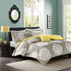 Update your space with luxurious style and comfort. This Intelligent Design Ciara comforter set combines a modern grey with a cool yellow reverse to highlight this beautiful white damask print.