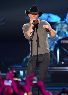 Fans take pics of superstar Kenny Chesney during his CMT Music Awards performance.