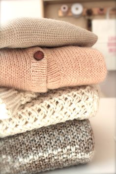stack of sweaters, chunky knits, pale palette, style, cozy style, cable, waffle, pretty sweaters, inside blush, boutique, blushshop,