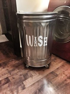 Industrial/Shabby Chic Farmhouse Laundry Basket. Galvanized trash can with caster wheels on the bottom for easy rolling.