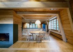 Wooden walls and roof trusses were left exposed throughout this chalet.