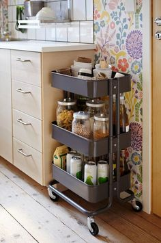 Cabinet overflow can be a problem for big families, so tuck your everyday pantry staples into the easy-grab caddies. You can roll the cart to the counter for prep, barely removing food containers from their home. See more at IKEA » - HouseBeautiful.com