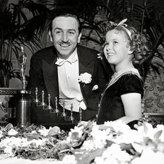 Academy Awards Ceremony held in 1939, Shirley Temple presented Walt Disney with a special award of an Oscar statuette with 7 miniature statuettes for Snow White and the Seven Dwarfs 1937