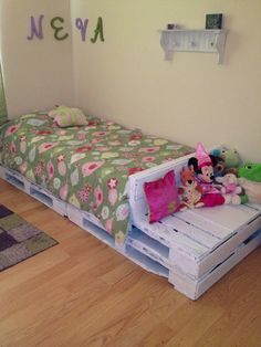 This is a bed made from four pallets and a few pieces of scrap wood and some paint we had lying around the house!  Total cost: around $5.50! Now our little princess has a place to sit while putting in her shoes, or just a little storage area for her stuffed animals!