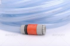 Garden Hose on White Background ...  background, blue, coil, contemporary, cut, cutout, equipment, garden, gardening, horizontal, hose, irrigate, irrigation, isolated, life, lines, modern, new, nobody, object, on, out, outdoors, pipe, plastic, round, rubber, shiny, shot, single, spiral, spray, sprinkle, still, studio, style, summer, tool, tube, wash, water, wet, white, work