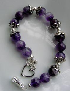 Brazalete en colores lilasy uva