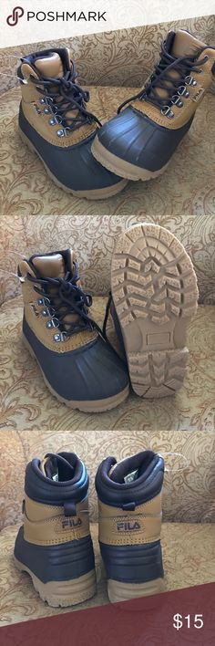 Boys Fila Weathertec boots Never been worn tag holder still attached to boot ( see pic ) - intended to purchase a larger size as my son owns a pair and loves them.  Keeps feet warm and dry in rain or snow!  Great choice for an all around boot! Fila Shoes Rain & Snow Boots