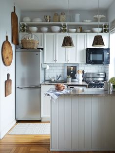 Small, stylish kitchen. Feather lampshade DIY.