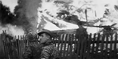 Soldiers from the Wiking Division enter a recaptured village in eastern Poland, after it been set on fire by the Soviets, July 1944. The Wiking Division was mentionated many times in Wehrmachtbericht (Wehrmacht Report) during the summer 1944, for its exemplary steadfastness and its superb conduct during successful counterattacks.