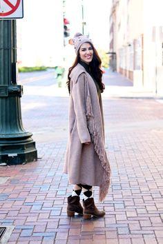 Fringe and Pom Pom Outfit. Fringe Sweater. Fringe Trim Sweater. Olive Green Turtle Neck Dress. Western Boots. Tan Western Boots. Argyle Socks. Pom Pom hat. Pom Pom beanie.