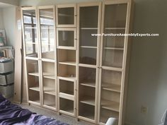 ikea billy oxberg bookcase assembled in south laurel MD for a customer moving in his apartment by Furniture Assembly Experts LLC