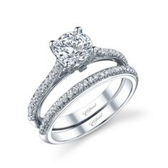 This classic Charisma design features diamonds decorating the shoulders of the ring, and a peek-a-boo diamond on the side of the head. A matching band completes the look.