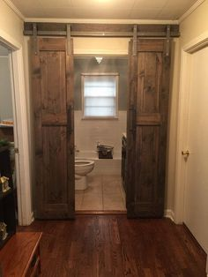 Barn Door Kit For Bathroomdouble sliding barn door hardware kit for two doors with 12 feet Double Sliding Barn Doors, Sliding Door Design, Interior Sliding Barn Doors, Sliding Barn Door Hardware, Door Latches, Rustic Hardware, Window Hardware, Sliding Wood Doors, Gate Hardware