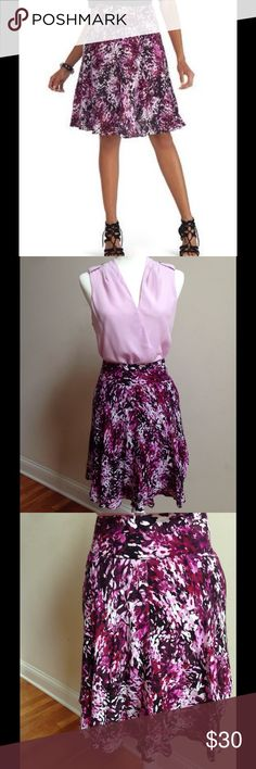 White House Black Market Skirt This totally feminine skirt from White House Black Market has so many beautiful shades of pinks and purples!  Never worn.  Top is listed here as well! White House Black Market Skirts