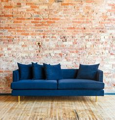 Globewest - Dark blue velvet for an eclectic Parisian look, with washed wooden floor & warm brick wall.