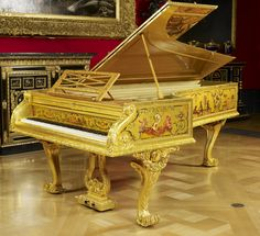 Grand piano Creator: S & P Erard (manufacturer) Creation Date: 1856 Materials:  Gilded, painted and varnished mahogany, satinwood and pine with brass and gilt bronze mounts Dimensions:  95.7 x 142.2 x 243.8 cm RCIN  2426 Acquirer: Queen Victoria, Queen of the United Kingdom (1819-1901), when Queen of the United Kingdom (1837-1901)