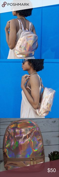 """Rocker Rose Gold Iridescent Backpack Ultra trendy and super chic! This bag is your perfect partner for shows, festivals or anytime you dress to impress!  Rose gold iridescent bag with gold metal hardware. Zip top closure & front zip pocket with adjustable shoulder straps.  10"""" (L) x 11.5"""" (H) x 5"""" (W) Bags Backpacks"""