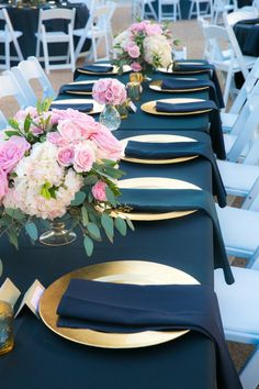 Gold + navy wedding reception place setting idea - navy table linens, gold plates and pink, floral centerpieces {New Seasons Photography}