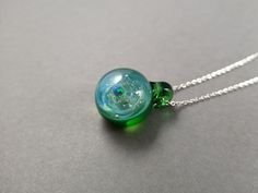 Handblown glass galaxy pendant with an opal planet, Silver fumed glass pendant, Universe Pendant with opal planet, Green Galaxy Pendant Green Galaxy, Small Planet, Glass Marbles, Green Earrings, Hand Blown Glass, Glass Pendants, Sterling Silver Earrings, Necklace Lengths, Planets