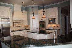 mom's kitchen, interesting back splash with  #peacockverde granite