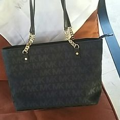 Black Michael kors handbag comes with dust bag Authentic Beautiful black and gold handbag Michael Kors Bags