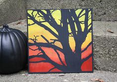 A spooky tree painted on canvas or wood makes a great decoration for Halloween! It's easy to do with this step by step tutorial!