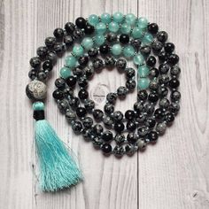 The Snowflake Mala. It's the first day of December, and winter is undeniably coming. To honor the beginning of this new season, I created this beautiful snowflake obsidian mala. To add some glacier touch to it I used ice-blue Mashan jade  and a gorgeous black and white cracked quartz as a guru bead.  #winter #snowflakes #ice #mala #malanecklace #yoga #yogajewelry #cocoandlimeyoga #108