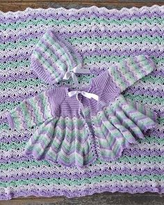 Watch Maggie review this beautiful Dainty Ripple Layette Crochet Pattern! Design By: Maggie Weldon Skill Level: Intermediate Size: To fit 3-9 months Afghan - 36