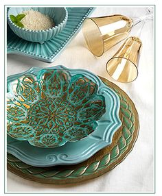 VIETRI's Damask Glass mixes gold and gorgeous aqua with multi-dimensional richness and reflects light differently according to the angles of the rays.  Perfectly lovely, maybe a little too busy though.