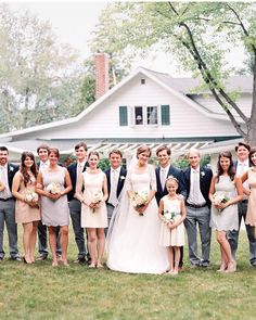 Bridesmaids at this rustic affair all wore different styles of dresses in various shades of blue, green, and taupe.