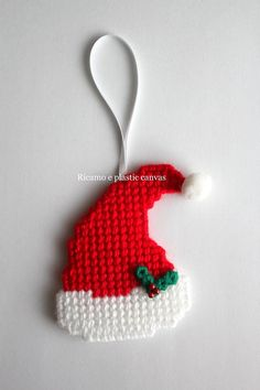 Santa hat ornament, christmas tree decorations, santa hat decoration, christmas gift idea, plastic canvas ornaments, santa claus, christmas This nice Santa hat is handmade by me with plastic canvas and wool acrylic yarn. Color: red and white Decorated with holly leaf on hat.