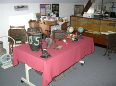 """The Bedford Historical Society offers a program entitled """"Artifacts through the Centuries."""" Students view and discuss  Native American artifacts from the collection of William H. Lewis, representing life prior to colonization"""