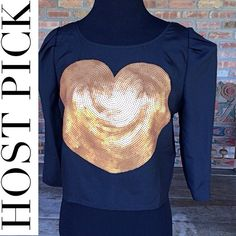 Black Crop Top With Gold Sequin Heart Super cute cropped top with gold sequin heart. Buttons in the back 🔹Material-100% polyester ❤️NWT 🔴Dry Clean Only ❌PayPal ❌Trades ❤️24 hour holds for returning customers only.  ⭕️Price firm even when bundled. Tops Crop Tops