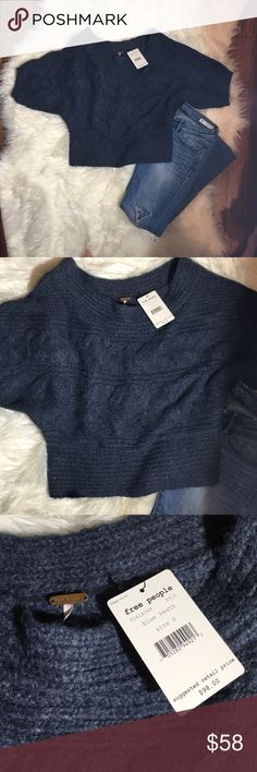 ✨SALE✨Free People Dolman Sleeve Crop Sweater NWT. Faded Navy Color gives way to a relaxed silhouette. Beautiful and classic cable knit with dolman sleeves. Cropped length hits perfectly to reveal a little white tee peeking through or a little skin! Your choice. Pair with your favorite denim and some ankle booties. Perfection!!! Free People Sweaters