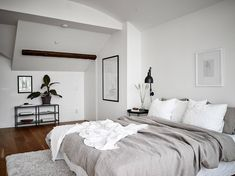 Neutral bedroom with a balcony view - COCO LAPINE DESIGN I like this minimal bedroom look in tints of beige combined with black accents. The beige works really well with the white walls and the natural wooden floor and gives the space a ver Bedroom Wooden Floor, Neutral Bedrooms, Masculine Bedrooms, White Bedrooms, Home Decor Bedroom, Bedroom Balcony, Bedroom Ideas, Master Bedroom, Bedroom Rustic