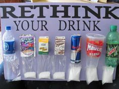 The post doesn't say who made this display, but it's a great way to visualize the amount of sugar in what you drink.