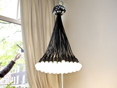 85 Lamps Chandelier by Droog | Ceiling | AHAlife.com