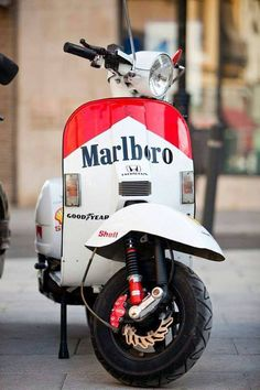 Marlboro & Vespa make a wonderful combination, especially in Italy, where Marlboro was a major sponsor of the Ferrari F1 team for years and years and years. The logo looks great on the vintage Vespa too. Very stylish and sure to get some comments from pals.