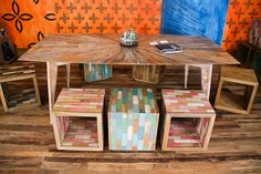 love this eco-friendly reclaimed Indonesian boat wood flooring made into furniture. Local San Diego company - Indoteak.