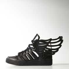 Cult designer Jeremy Scott made his mark in the adidas style universe with his beloved series of winged footwear. Stripped down and cut away, these Wings 2 Cutout shoes are all about what isn't there. Featuring a black leather upper with crisp cutouts, these bold graphic shoes display the designer's unmistakable wing motif merged with transparent TPU panels for a see-through look.