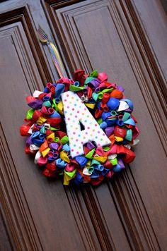 Balloon Wreath on door for birthday month!!