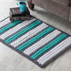 Pull your room together with this simple striped crochet rug