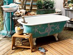 Forget a quick rinse in an outdoor shower - opt for a long soak under the stars. Turn a private deck into an outdoor bath with a freestanding tub and pedestal sink for the ultimate alfresco experience. A flea-market stool can keep accessories nearby. (Photo: Lisa Romerein)