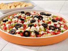 Mediterranean Dip: Hummus, tomato, cucumber, feta cheese, black olives