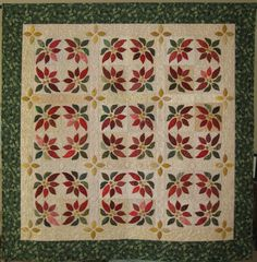 Poinsettia Wreaths  To my dear friend Shelly,  Everytime I find an amazing quilt you have been there first!  You have fabulous taste!