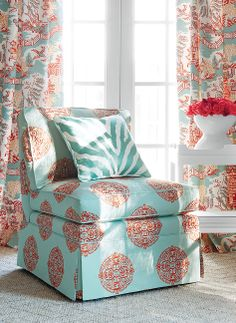 Chelsea Chair from Thibaut Fine Furniture in Halie Embroidery fabric in aqua and coral. Pillows in Etosha Embroidery fabric in aqua. Draperies in Luzon fabric in aqua and coral Thibaut