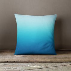 Decorative pillow cover with a blue gradient.