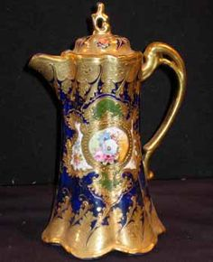 Handpainted Nippon Chocolate Pot, cobolt blue with floral medallion on each side, heavy gold trim and handle Japanese Porcelain, Cold Porcelain, China Porcelain, Porcelain Black, Porcelain Tile, Delft, Chocolate Cups, Teapots And Cups, Coffee Set