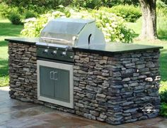 Cape Cod is a stunning real thin stone veneer with light gray and tan tones. It looks fantastic with stainless steel appliances on this outdoor grill and kitchen. #naturalstone #stoneveneer #thinstone #realstone #quarry #freeshipping #thinstoneveneer #thinveneer #masonry #realstoneveneer #naturalstoneveneer #quarrymill #buildingmaterials #outdoorkitchen #outdoorgrill #stonekitchen #outdoorliving
