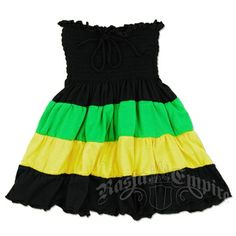 This short smocked little girls' dress is made of Jamaican colored tiered strips of fabric transitioning from black on the top to green, yellow, and again black at the bottom. The bodice has elastic strips sewn in for a comfortable fit all around. A black string is attached a the top of the bodice to tie around the neck as a halter. The skirt has ruffles throughout for a fun playful look. Made of 100% Cotton.